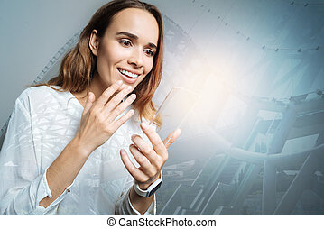 Positive happy woman holding her gadget