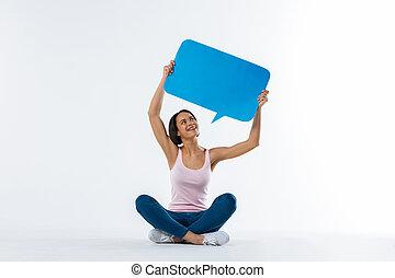 Positive happy woman sitting on the floor
