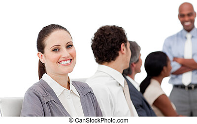 Positive international business people at a presentation