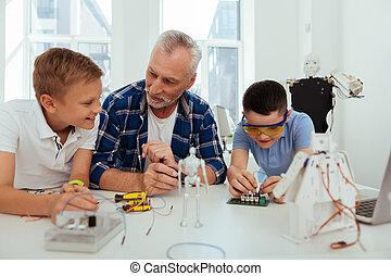 Positive joyful children having a practical class