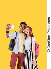 Positive joyful friends taking a selfie