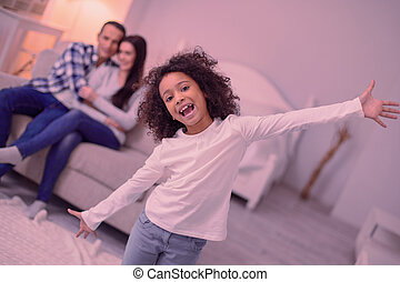 Positive joyful girl enjoying time at home