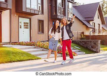 Positive joyful man showing the neighborhood to his girlfriend