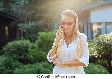 Positive joyful woman having a phone conversation
