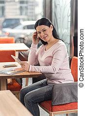 Positive joyful woman visiting a cafe