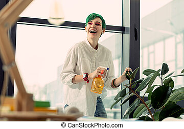 Positive joyful young woman enjoying her time