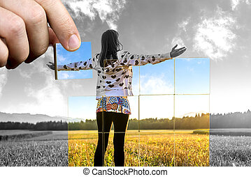Young woman standing on field with hands wide open. Concept of positive personal perspective toward life.
