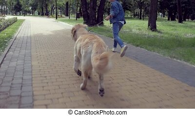 Positive little boy running with his dog