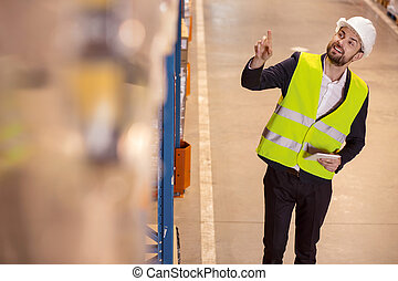 Positive logistic manager pointing at the box