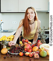 Positive long-haired woman with ripe fruits