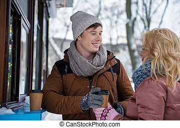 Positive loving couple dating in winter park - Joyful young...