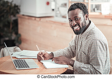 Positive male student studying