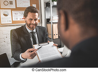 Positive man is showing contract