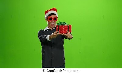positive man with a gift. green screen. Slow motion