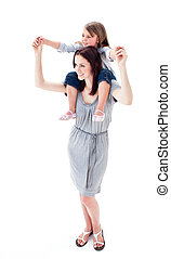 Positive mother giving her daughter piggyback ride
