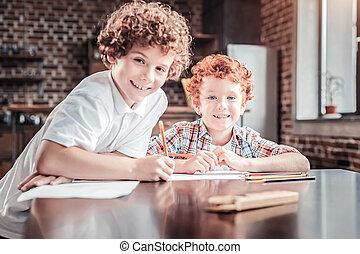 Positive nice boys drawing together