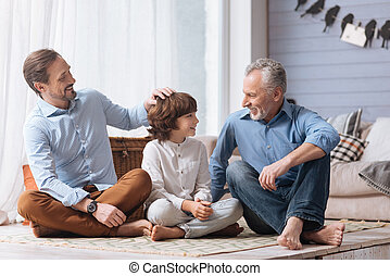 Positive nice man pulling his sons hair