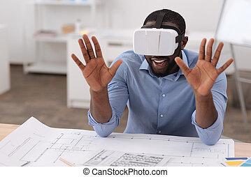 Positive nice man wearing 3D glasses