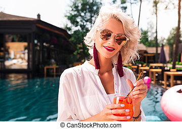 Positive nice woman enjoying her summer rest