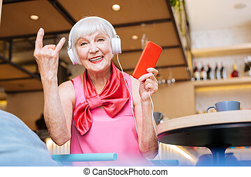 Positive nice woman sitting in the cafeteria