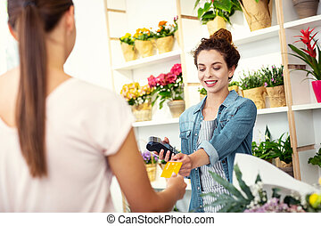 Positive nice woman standing opposite the customer