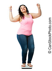 Positive overweight girl on diet scale. - Teen girl with...