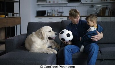 Positive parent tossing the ball for little son