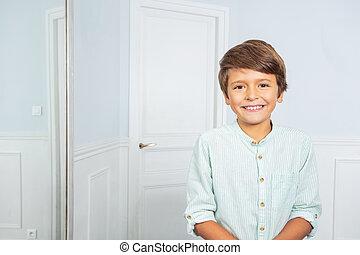 Positive portrait of little boy at home smiling