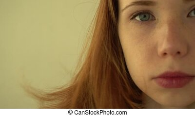 Positive red-haired girl smiles - Positive redhead girl...