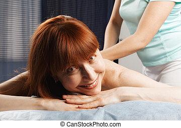 Positive redhead having a massage