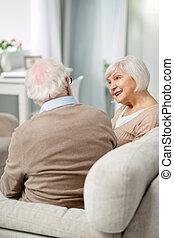 Positive senior couple having a conversation