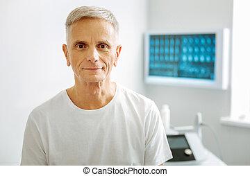 Positive senior man looking at you