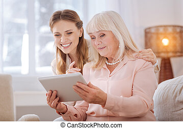 Positive senior woman using new technology