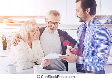 Positive smiling couple meeting with their real estate agent