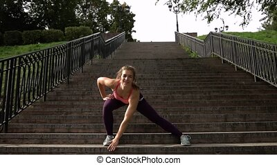 Positive SportsWoman In Sports Clothes Warming Up