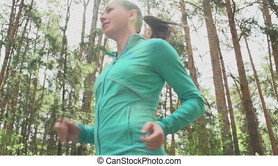 Positive Start of the Day - Tracking slow-mo of girl running...