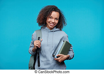 Positive student girl with books