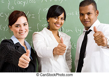 positive teachers - group of teachers with their thumbs up