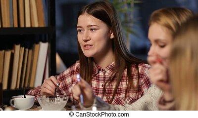 Positive teenage friends meeting at restaurant
