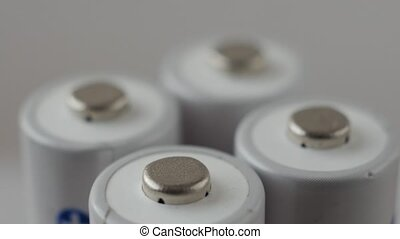 Positive terminals of batteries rotating slowly