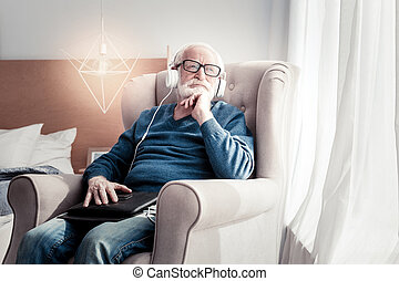 Positive thoughtful man enjoying his pastime