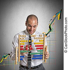 Positive trend - Businessman with abacus calculates a ...