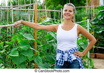 Positive woman in garden on summer day