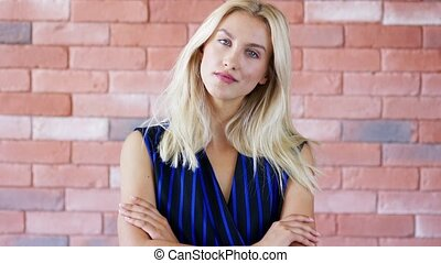 Positive woman near brick wall - Pretty young lady in...