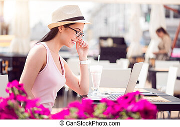 Positive woman sitting in the cafe