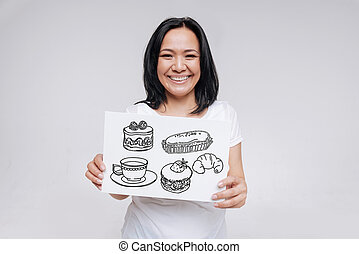 Positive woman smiling while ordering tasty sweet food