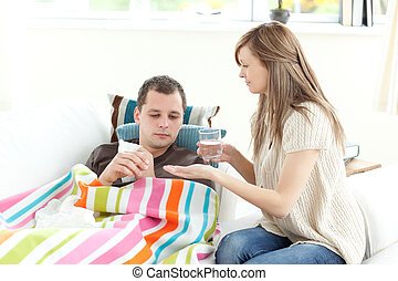 Positive woman taking care of her husband at home
