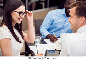 Positive woman talking with her colleague