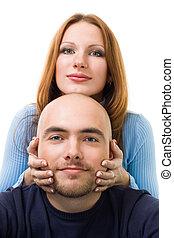 positive woman touching men's head