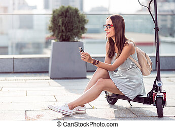 Positive woman using cell phone
